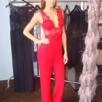 Red jumpsuit by Joelle Flora
